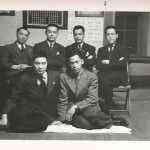 """The caption on the back of the picture reads """"Back row. Phil, Don, Kuey, Joe./ Sitting. Fay. Frank."""""""