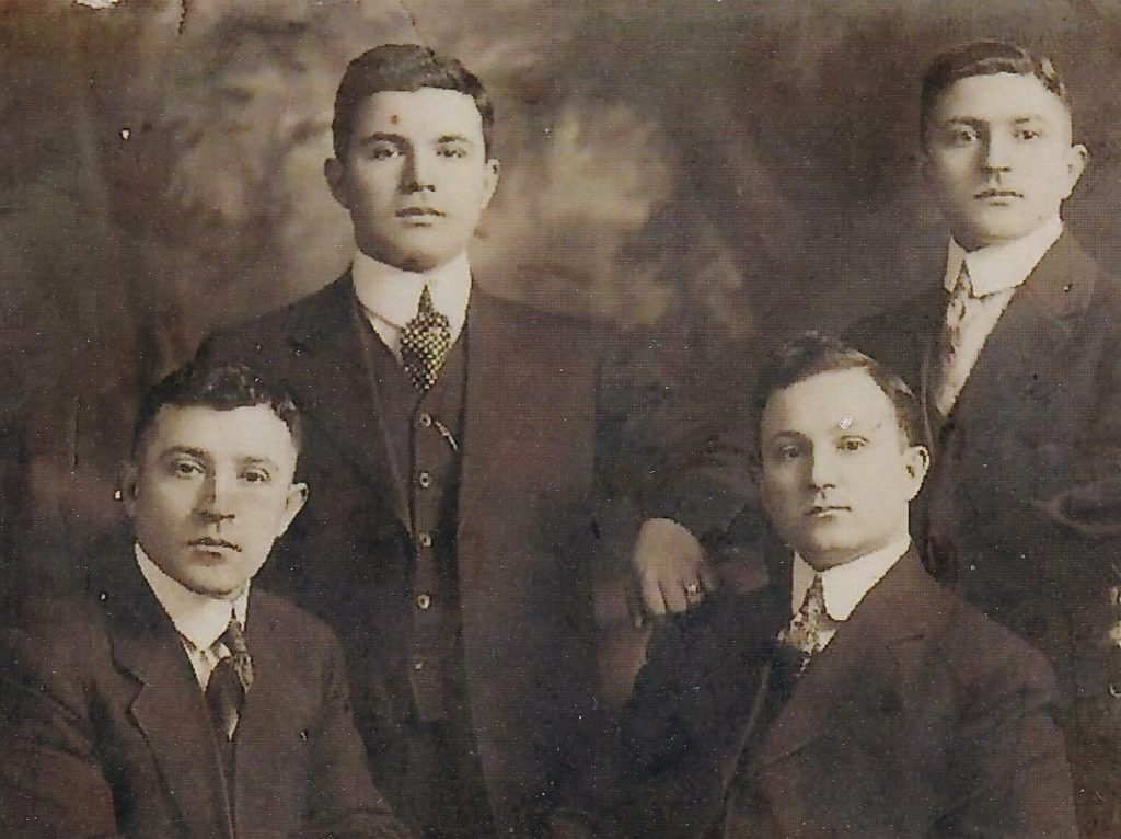 Andrew Sakell (Standing, Left) with his brothers George Sakell (standing right), Greg (seated left) and Tom Sakell (seated right).