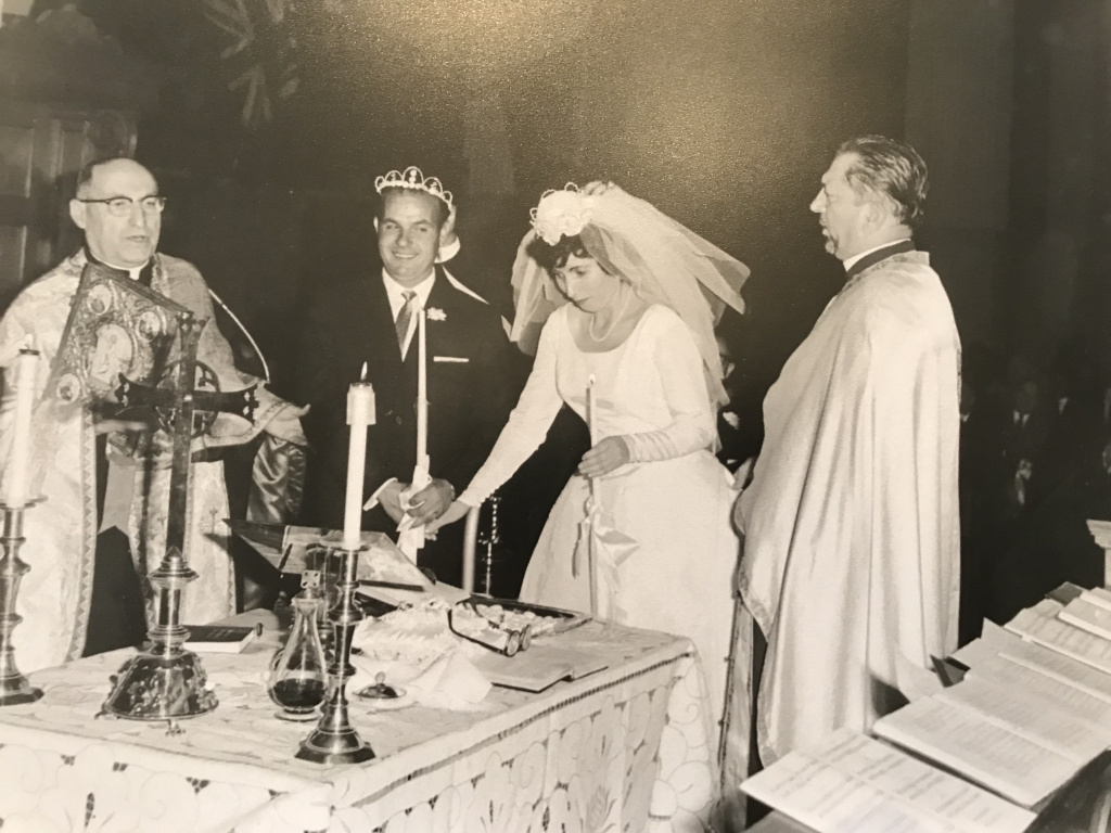 Toula and Louis Leos during their wedding in 1963 at St. George's Cathedral. All of the Orthodox props included in the ceremony (such as the crowns on their heads) were brought to St. George's for the wedding.