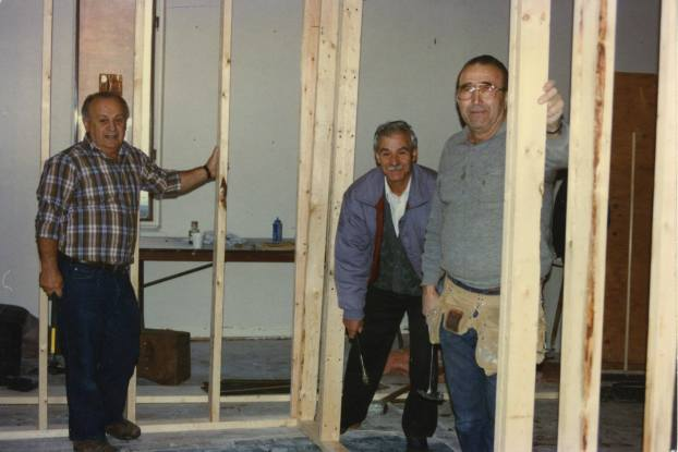 A photo of some Greek Community members working on constructing the first church hall and the bar.