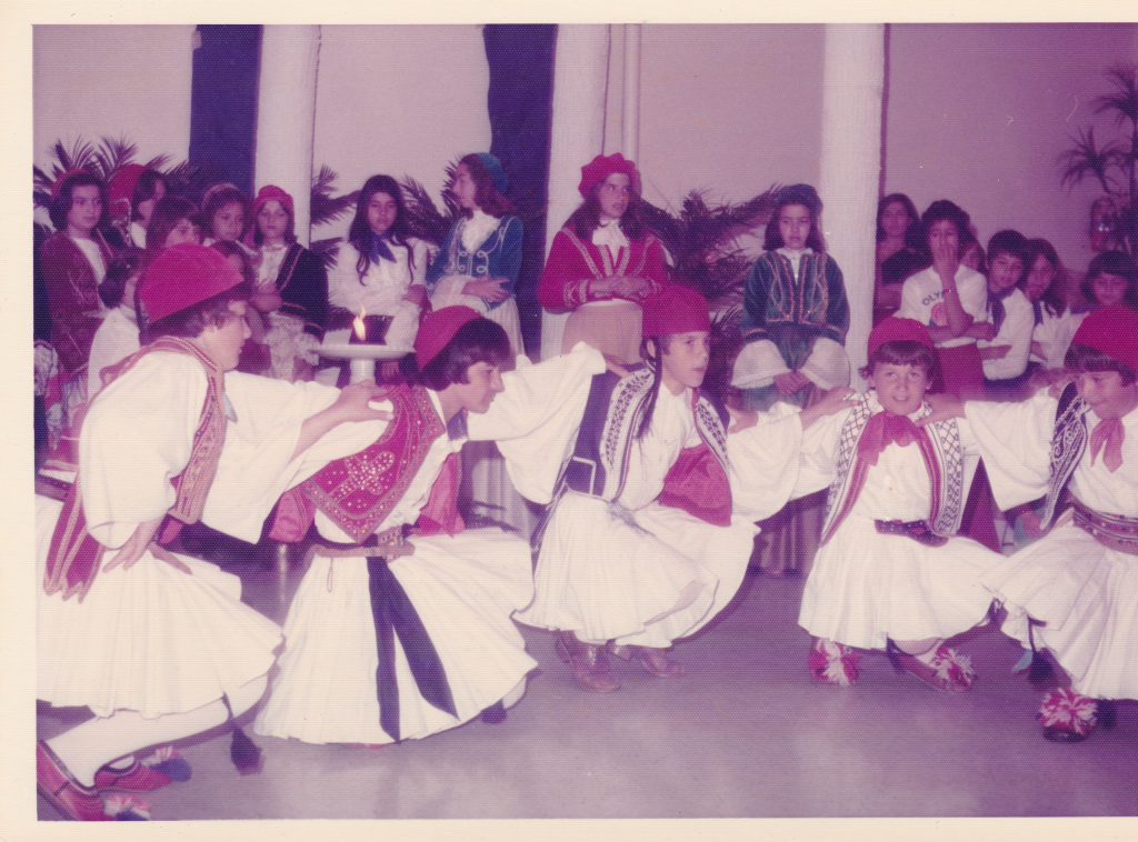 Traditional Greek costumes, worn by youth in the Kingston Greek Community in the 1970's as they dance a traditional Greek dance. During May 25th celebrations, such traditional Greek dances are preformed in traditional dress, along with the reading of Greek poems and the hosting of a Greek feast attended by many.