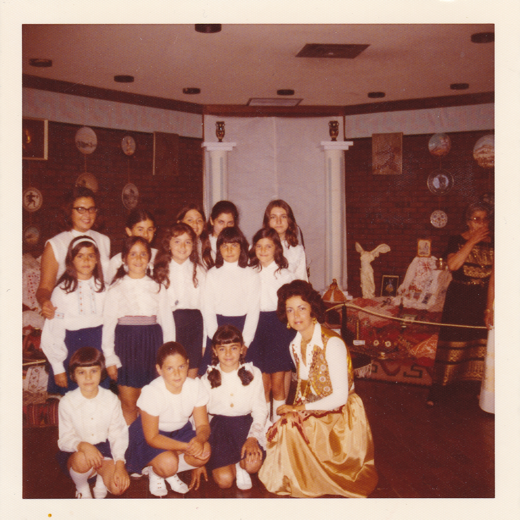 Maria Triada Karkoulis with a group of students at Folklore in the 1970s.