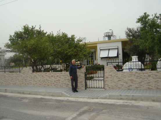 A recent photo of Andreas visiting his family home in Boghazi.