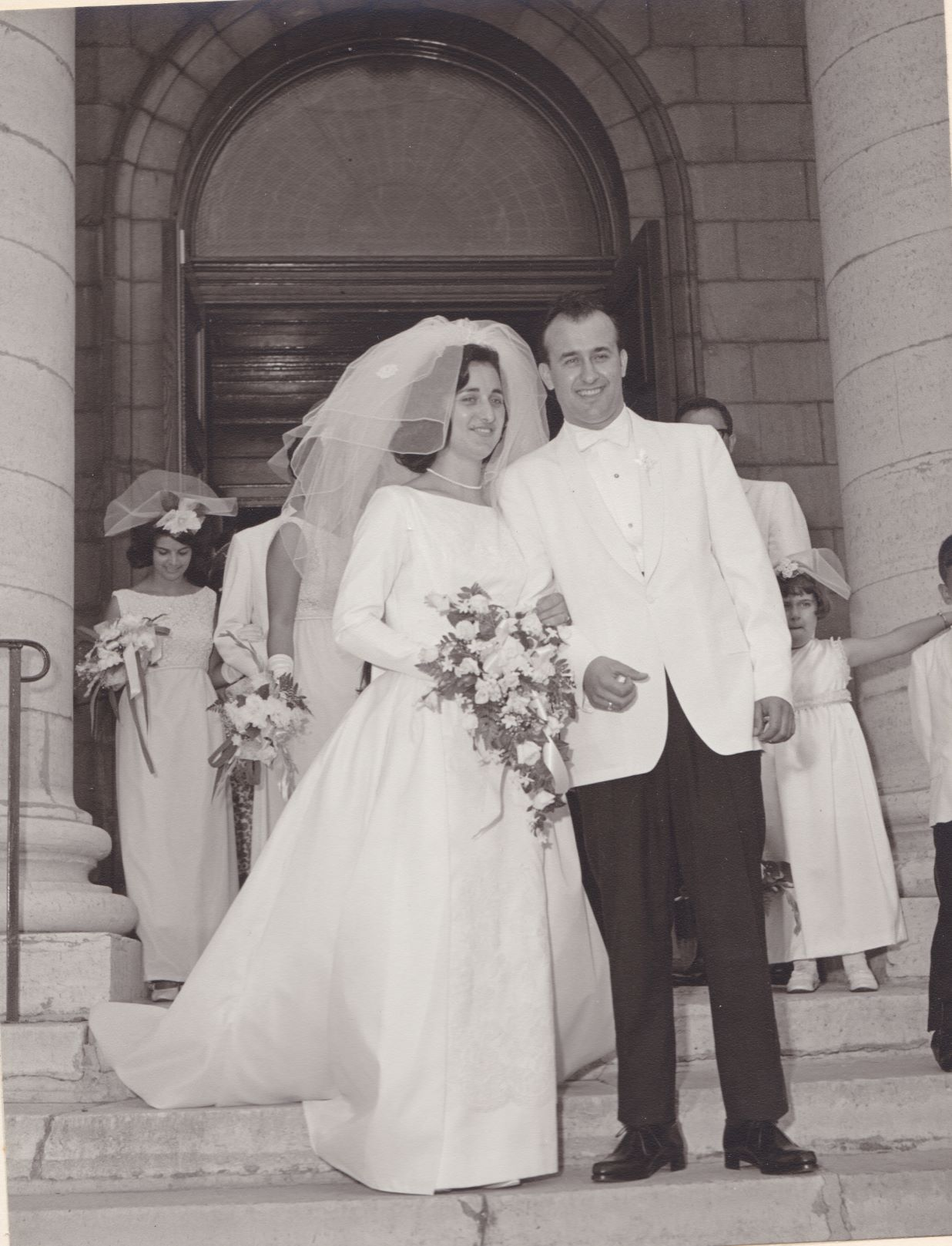 This is a photo from Tom and Voula Stathopolous's wedding, which took place at St. George's Cathedral. In this photo, they are exiting the steps of the cathedral.